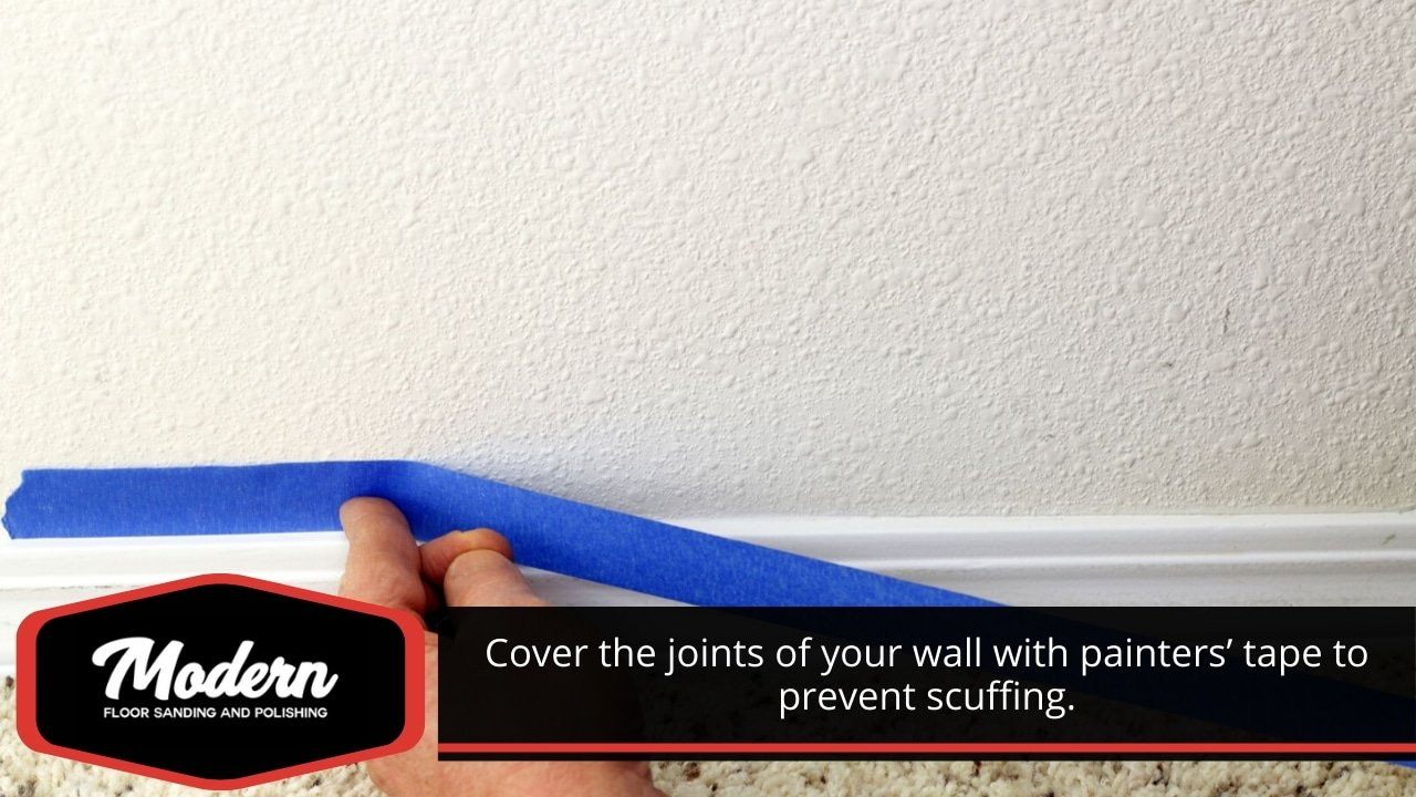 Cover the joints of your wall with painters' tape to prevent scuffing.